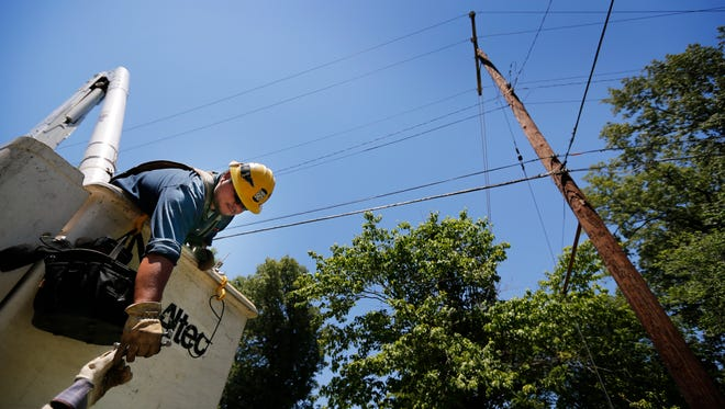 A MemphisLight, Gas and Water worker repairs damaged utility lines in South Memphis on May 30, 2017.