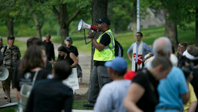 Brian Taylor, an organizer with Black Lives Matter Cincinnati speaks during a rally at Inwood Park in the Mt. Auburn neighborhood of Cincinnati on Wednesday, May 31, 2017.