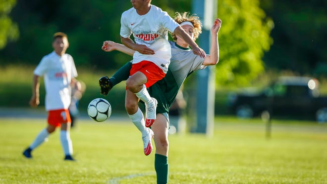 Iowa City West'sColeson Krupp ties up with Cedar Rapids Prairie's Jole Collett during their 3A quarterfinal at the Iowa boys' state soccer tournament in Thursday, June 1, 2017, in Des Moines, Iowa. West defeated Prairie 7-6 in shootouts.