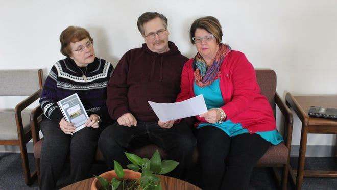 Christine Jeske (far left), Outreach Coordinator at the Aging & Disability Resource Center (ADRC) of Sheboygan County, shares information with Nancy La Pearle and Gary Brendel about the many services offered by the ADRC to Sheboygan County residents.
