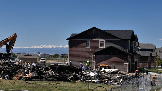 FILE - In this May 4, 2017 file photo, workers dismantle the charred remains of a house at the location where an unrefined petroleum industry gas line leak explosion killed two people inside their home,in Firestone, Colo. Regulators say the energy industry appears to be complying with inspections of oil and gas pipelines ordered following the blast. (AP Photo/Brennan Linsley, File)