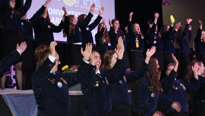 FFA members work to fire up the crowd during the final session of the 2016 FFA Convention in Madison.