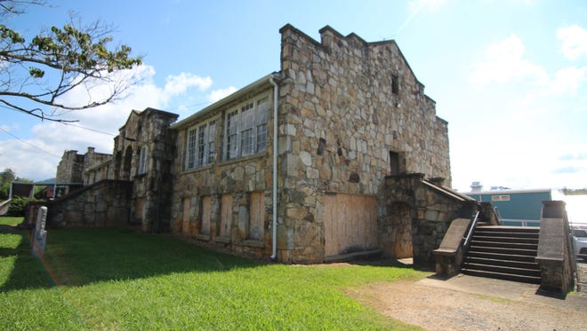 The former Mars Hill High School, deemed surplus property by the Madison County Board of Commissioners, is the subject of a $65,000 bid.