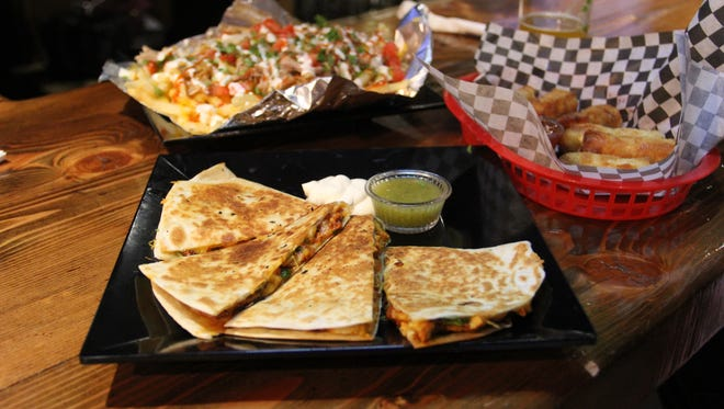 Quesadilla, Victory Fries and J's Egg Rolls all arrive at Victory Club, Vagabond's downtown beer bar.