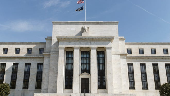 The U.S. Federal Reserve Bank Building, home to the Board of Governors of the Federal Reserve System, is seen in Washington, Friday, April 25, 2014. Often referred to as ìthe Fed,î it is the nationís central banking system and sets monetary policy for the United States. (AP Photo/J. Scott Applewhite)  ORG XMIT: DCSA202