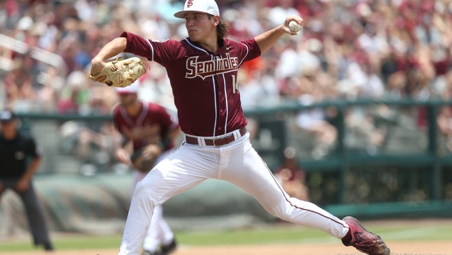 FSU's Tyler Holton pitches against Sam Houston State during the Seminoles 7-6 in NCAA Super Regional win at Dick Howser Stadium on Saturday, June 10, 2017.
