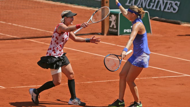 Bethanie Mattek-Sands of the U.S., left, and Lucie Safarova of the Czech Republic celebrate winning women's doubles final match against Australia's Ashleigh Barty and Casey Dellacqua in two sets 6-2, 6-1, at the French Open tennis tournament at the Roland Garros stadium, in Paris, France, Sunday, June 11, 2017.