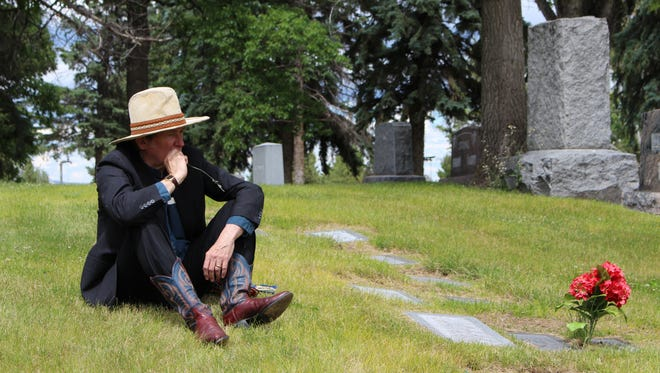 Bill Bronson plays Charlie Russell during the Waking the Dead tours at the Highland Cemetery outside Great Falls.