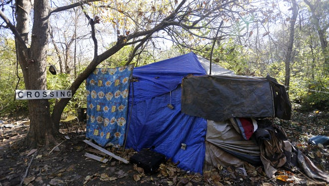 This is a file photo of a tent in the homeless camp near Kearney and Glenstone.