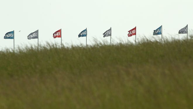 A general view of the USGA flags flapping in the wind during the opening practice round.