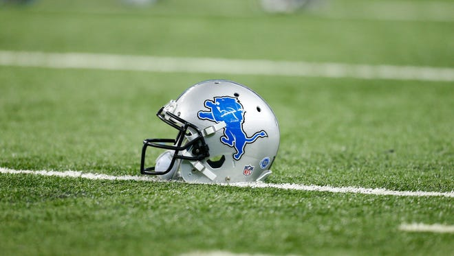 A Detroit Lions helmet is seen on the field before during the first half of an NFL football game against the Minnesota Vikings, Sunday, Oct. 25, 2015, in Detroit.