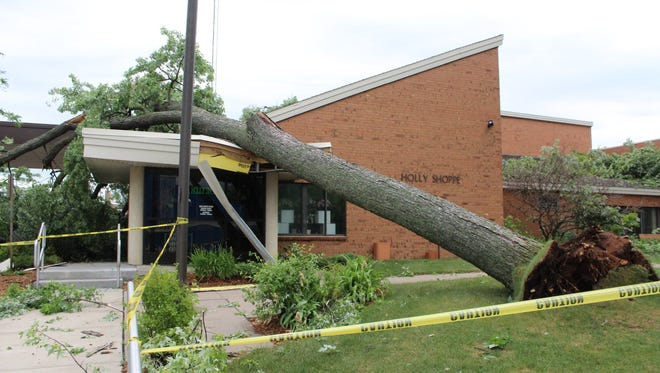 A tree rests on top of the entrance to the Lincoln Center in Stevens Point on Tuesday morning.