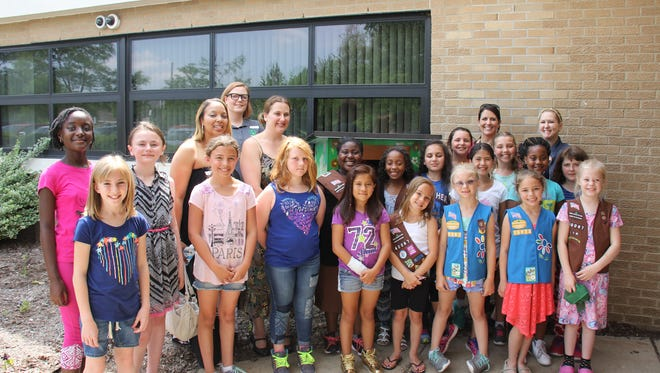 The Brownie Troop recently cut the ribbon on a new lending library at Walker-Winter.