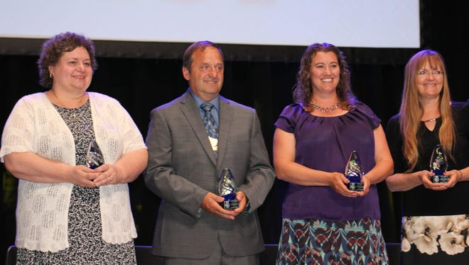 Recipients of the Distinguised Service Awards are (from left) Colleen Geurink, Kevin Hoffman, Regina Oldendorf and Brenda Scheil.