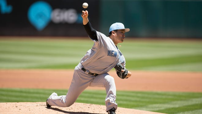 Masahiro Tanaka delivers a pitch during the first inning against the Oakland Athletics at Oakland Coliseum.