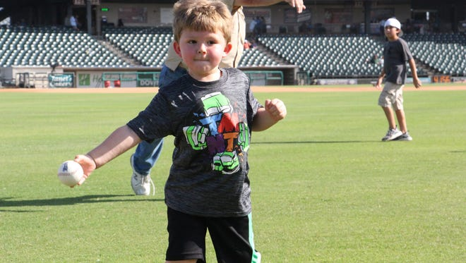 Karl III plays catch with his dad for Father's Day on Sunday, June 18, 2017, during the Corpus Christi Hooks' Faith and Family Night at Whataburger Field.
