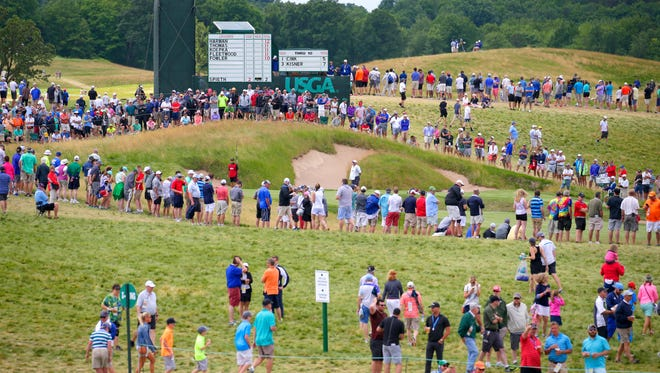 Spectators line the grounds during the final round of the 2017 U.S. Open Championship at Erin Hills on Sunday, June 18, 2017.