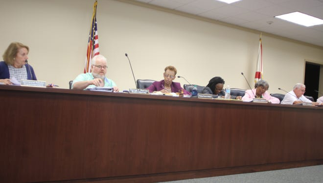 Members of the Jefferson County School Board hear from DOE representatives at its emergency meeting June 19.