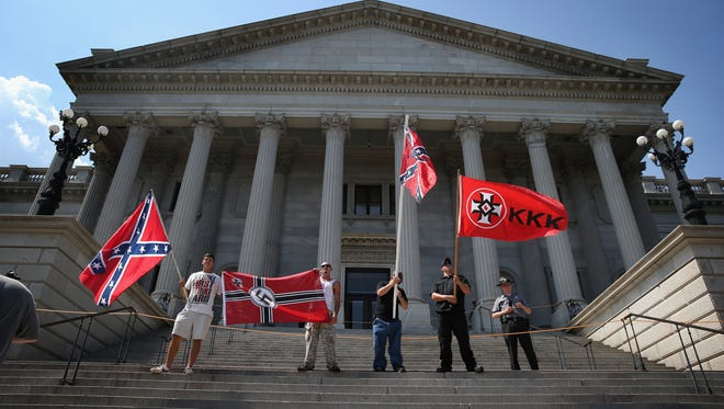 Ku Klux Klan members take part in a demonstration at the South Carolina state house on July 18, 2015, in Columbia, S.C.
