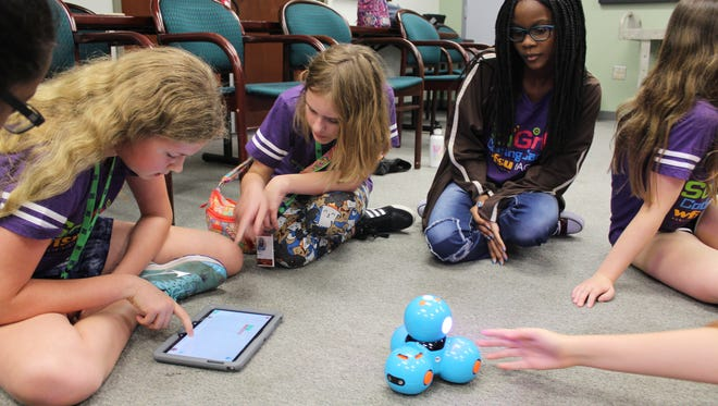 Campers program a robot through coding language Blockly at  the first ever SciGirls Coding Camp.
