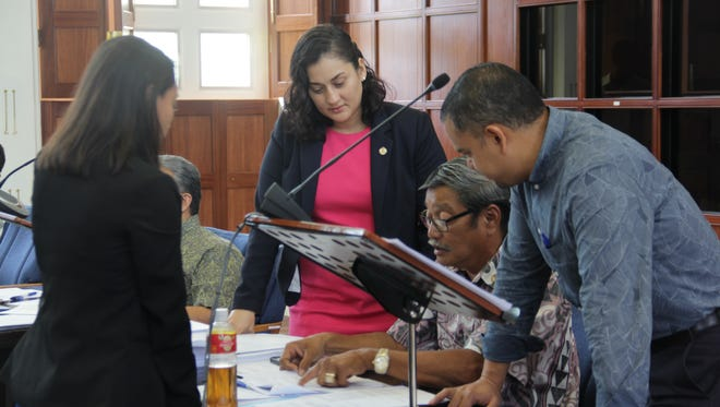 I this June 28 file photo, Sen. Joe San Agustin, second from right, talks with fellow Democratic Sens. R´gine Biscoe Lee, left, Telena Nelson, second from left, and Dennis Rodriguez Jr., right.