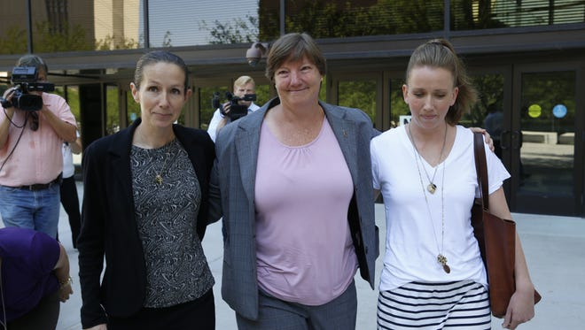 A mistrial was declared in the trail of five former El Paso Independent School District administrators accused of participating in a districtwide cheating scheme. Former Austin Assistant Principal Diane Thomas, center, stands between her lawyer, Sherilyn Ann Bunn, left, and her pastor.
