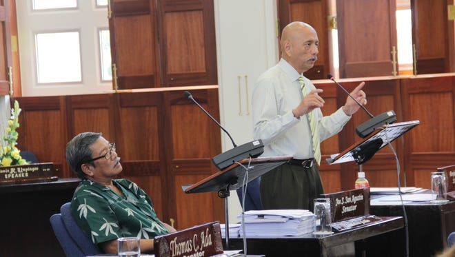 During session on June 29, Speaker Benjamin Cruz (right) goes over some recent changes his Committee on Appropriations made to the Simon Sanchez High repair measure, Bill 87-34. The bill, which Sen. Joe San Agustin (left) authored, proposes to appropriate legislative coffers to the education department to make emergency repairs at Sanchez High.