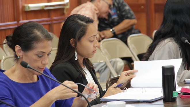 During a Committee on Rules meeting on July 5, Sen. Regine Biscoe Lee, D-Tamuning, looks over the legislative resolution that named her as the committee's new chairwoman.