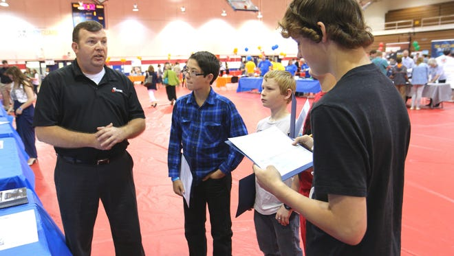 During the 2016 career exploration event at Vol State, Jeffrey Fullerton with Hitachi-Vantec spoke to Westmoreland Middle students about why geography is important for logistics work. From left are Tyler Warren, Robert Abbott, Blaine Sams and Dalton Profitt.
