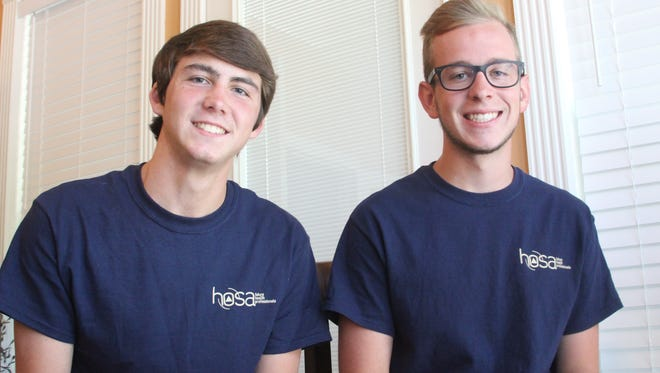 Greenbrier High School students Spencer Hall, left, and Joshua Barnes, right, invented an implant that can act as an alternative to rhinoplasty. They entered it in the statewide HOSA medical competition and won. They later competed in the national competition.