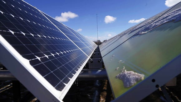 Solar panels, like these at the Wright- Hennepin Cooperative Electric Association's community gardens  in Rockford, Minn., have become more economical.