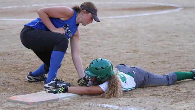 Montezuma first baseman Breck Goodman tries to put a tag on a St. Edmond, Fort Dodge runner during the Bravettes' 7-1 win in the Class 1A-Region 3 final sending Montezuma to the state tournament.