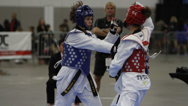 P-CEP's United's Katherine Springer (left) competes in a sparring event July 6 at Cobo Center in Detroit.