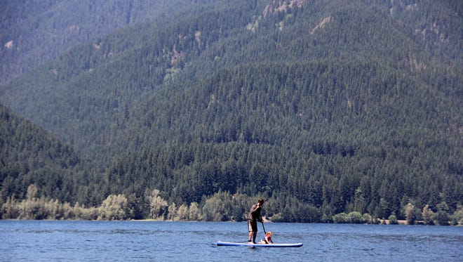 File photo of stand-up paddleboard. Six people have died in Oregon this spring after falling into cold water.