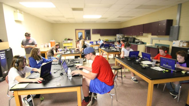Campers at the Mod Design Camp work diligently to create new additions to the Minecraft computer game.