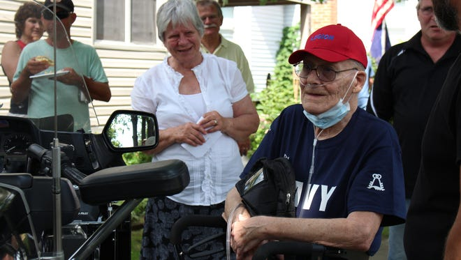 New Washington Navy veteran Mike Jaynes, with his wife of 53 years Helen Jaynes in the background, smiles after a pinning ceremony Sunday, July 16, 2017. The ceremony was part of an OhioHealth Hospice program meant to honor veterans approaching the end of their lives.