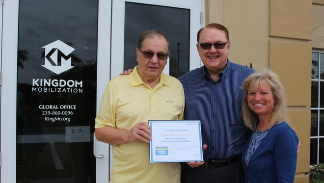 Kingdom Mobilization chairman, Jerry Findley, left, and its founder, Nolen Rollins, right, stand with Deb Logan, executive director of The Blue Zones Project.