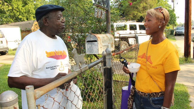 Renee Beavers, right, chats with Moses White during Saturday morning's neighborhood walk as part of the Health and Wellness event. Alvin Benn/Special to the Advertiser