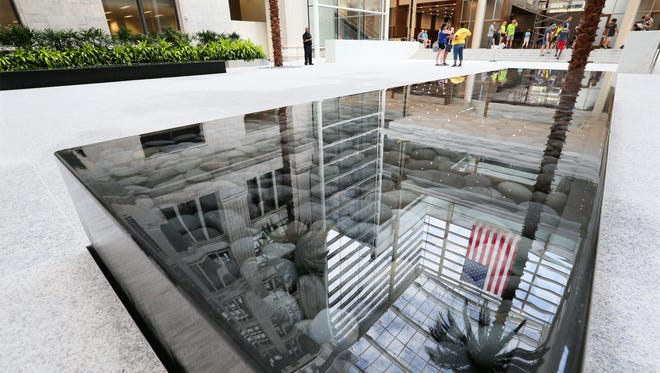 A reflective pool highlights the atrium area of Northwestern Mutual Life Insurance Co. financial new building on E. Wisconsin Avenue.