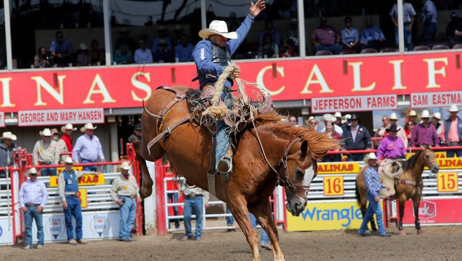 FILE: Isaac Diaz competes in saddle bronc riding at the 107th California Rodeo Salinas