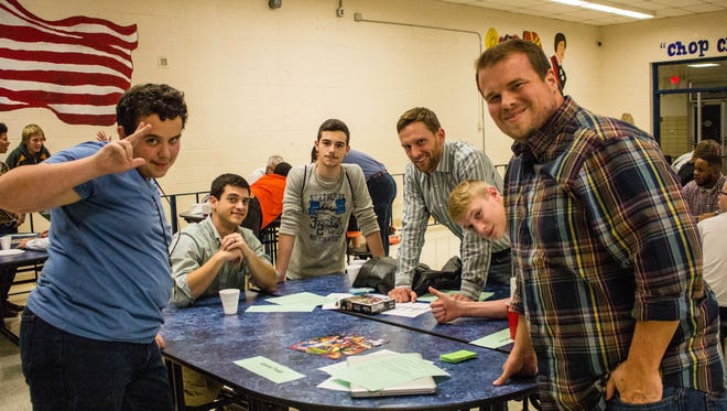 Students Marvin, Ethan and Geoffrey meet with their mentors, Aaron, Jack and Tony, at South-Doyle High School last year during a Mentor 2.0 session.