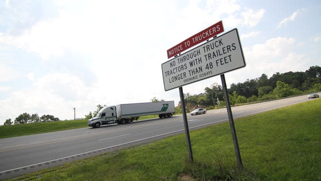 A sign along U.S. 25-70 in Marshall warns truckers of restrictions on the bypass through Madison County.