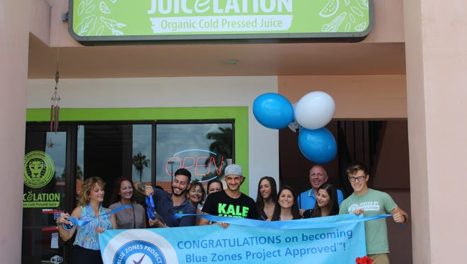 Employees of Juicelation celebrate Blue Zones recognition