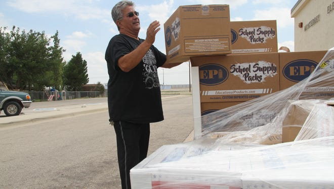 Monterrey Elementary head custodian Abel Lopez takes boxes of school supplies from the curb after they were delivered, Monday, July 31, 2017. Lopez has worked for the Carlsbad Municipal Schools district for the last 17 years and two of those years at Monterrey.