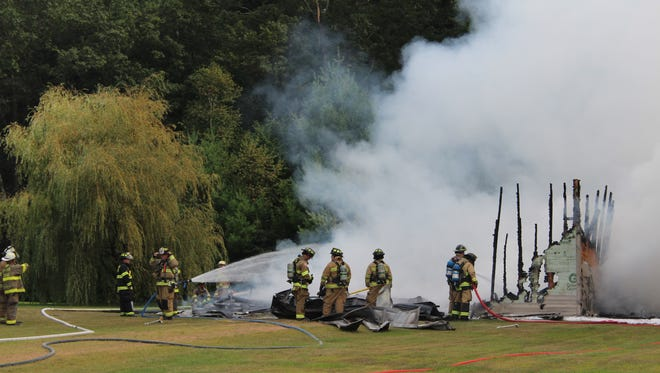Firefighters respond to a garage fire Monday afternoon in the town of Hull.