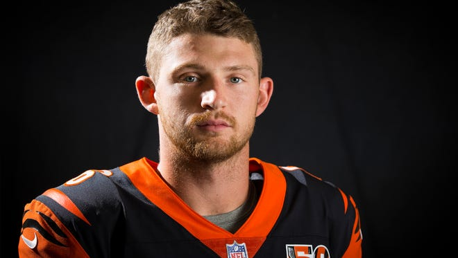 The all-orange collar and 50th anniversary patch are new for the 2017 Cincinnati Bengals uniforms, as quarterback Jeff Driskel shows.