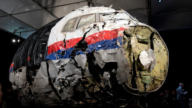 The reconstructed wreckage of Malaysia Airlines Flight 17 is put on display Oct. 23, 2015, during a press conference in Gilze-Rijen, central Netherlands.