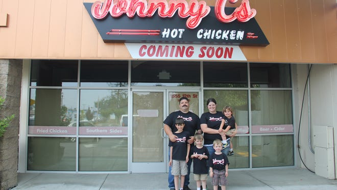 The Crow family stands outside Johnny C's Hot Chicken, a Southern restaurant the family plans to open in August.