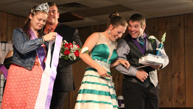 Rebecca Gregg and Hunter Tilton react after they are announced as the 2017 Richland County Junior Fair king and queen Sunday, Aug. 6, 2017. Standing to their left are the 2016 king and queen, Warren Rehberg and Kelcie Chance.