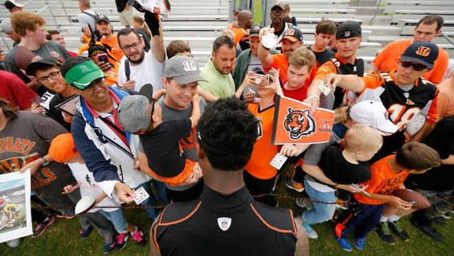 Cincinnati Bengals running back Joe Mixon (28) signs autographs for fans after practice at Bengals training camp at the Paul Brown Stadium practice facility in downtown Cincinnati on Monday, Aug. 7, 2017.